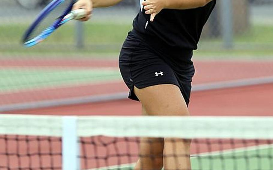 Two ways people at Zama can tell No. 1 tennis singles player Megan Petros apart from her senior twin Marissa ... is to look for the orange shoes and the blue-rimmed racket.