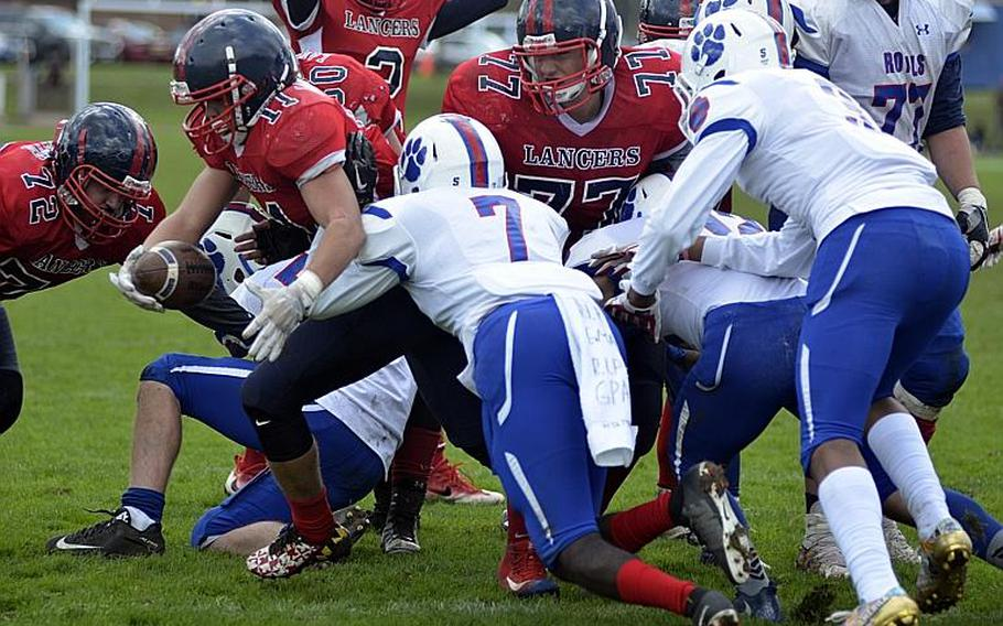 Lancer fullback Manny Cordero sheds the Ramstein defense for a goal-line touchdown at RAF Lakenheath, England, Saturday, September 30, 2017.