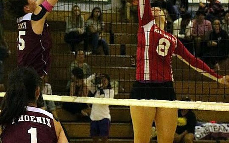 Nile C. Kinnick's Faith Hughes tries to tip the ball past Seisen's Amanda Wood.