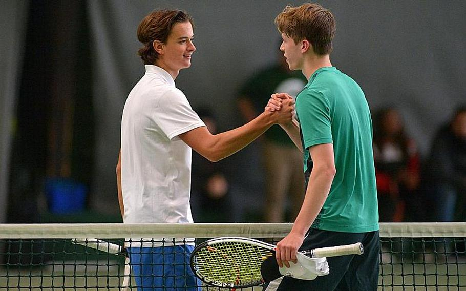 Marymount's Mathias Mingazzini, left, shakes hands with SHAPE's Noah Banken after defeating him 6-2, 6-1 to defend his boys singles title at the DODEA-Europe tennis championships in Wiesbaden, Germany, Saturday, Oct. 28, 2017.