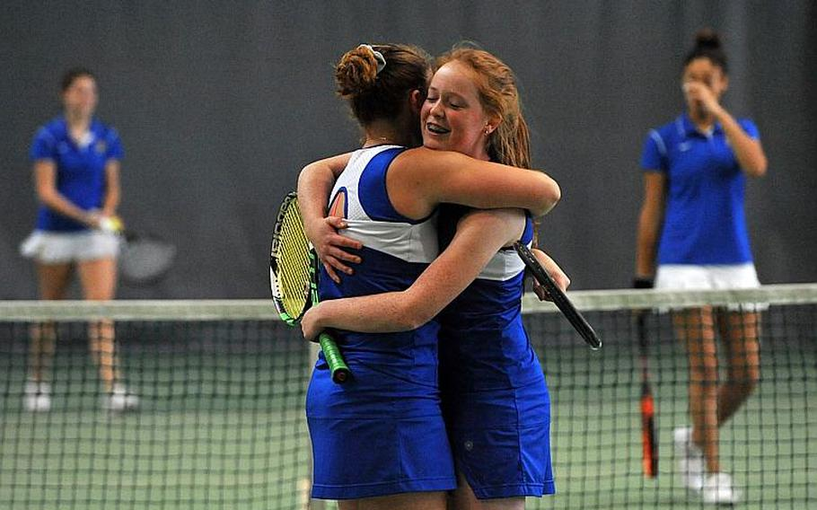 Megan Stretch, right, hugs teammate Amanda Daly after the Ramstein doubles team defeated Wiesbaden's Shelby Albers and Melissa Pritchett 6-2, 6-1 to take the title at the DODEA-Europe tennis championships in Wiesbaden, Germany, Saturday, Oct. 28, 2017.