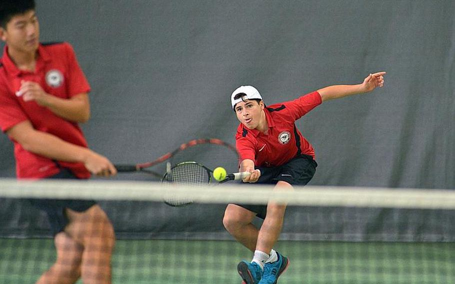 American Overseas School of Rome's Federico Sarti rushes in to return a short shot as teammate William Hsia gets out of his way in the boys doubles final at the DODEA-Europe tennis championships in Wiesbaden, Germany, Saturday, Oct. 28, 2017. The pair defeated SHAPE's Seth Banken and Gregor Vargas 6-2, 6-2.