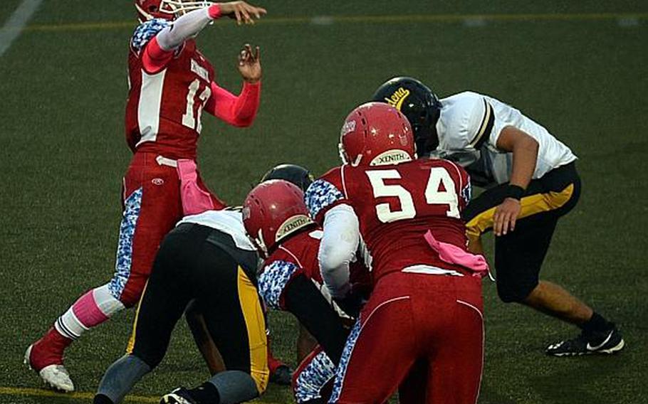 Nile C. Kinnck quarterback Kacey Walker lets fly.
