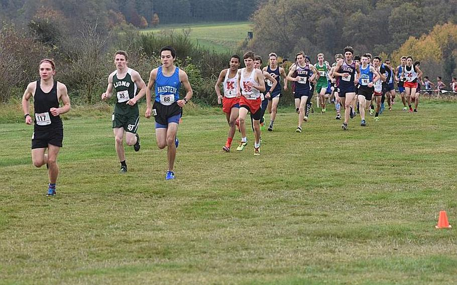 Runners start to spread out in the first mile of the boys' race in the DODEA European cross country championships on Saturday, Oct. 28, 2017, in Baumholder, Germany, including Stuttgart's Paul Fullwood, in black, Ramstein's Jose Serrano and St. John's Isaiah Lowney.