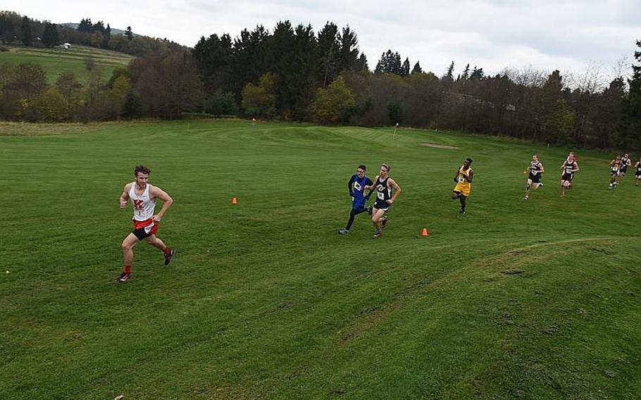 A Kaiserslautern runner looks over his shoulder during the boys' race in the DODEA European cross country championships on Saturday, Oct. 28, 2017, in Baumholder, Germany.