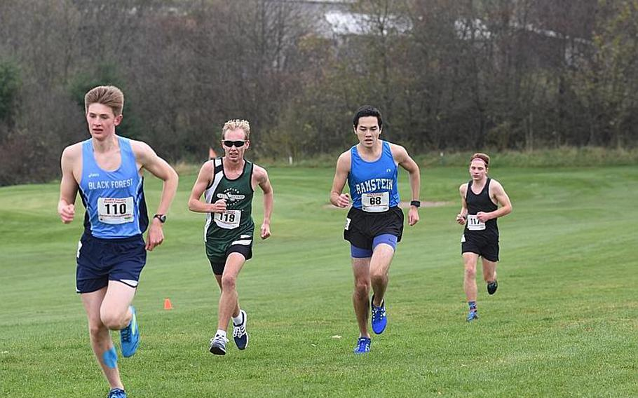 Naples' Daniel Aleksandersen, Ramstein's Jose Serrano, and Stuttgart's Paul Fullwood were in hot pursuit of frontrunner and eventual winner Mac Roberts of Black Forest Academy during the DODEA European cross country championships on Saturday, Oct. 28, 2017, in Baumholder, Germany.