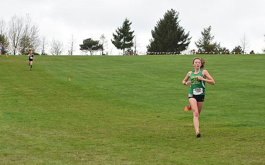 SHAPE's Holly Moser races ahead on the downhill of Stuttgart's McKinley Fielding during a portion of the DODEA European cross country championships on Saturday, Oct. 28, 2017, in Baumholder, Germany. Moser and Fielding finished third and fourth, respectively, overall in the girls' race.