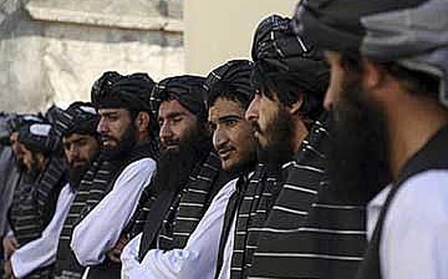 Afghan prisoners line up after their release from Pul-e-Charkhi prison, in Kabul, Afghanistan, Thursday, Jan. 11, 2018. The Afghan president pardoned 75 prisoners loyal to Gulbuddin Hekmatyar, a former warlord and U.S.-declared terrorist who signed a peace agreement with Kabul in 2016. The deal gave Hekmatyar and his followers immunity for past actions and granted them full political rights.