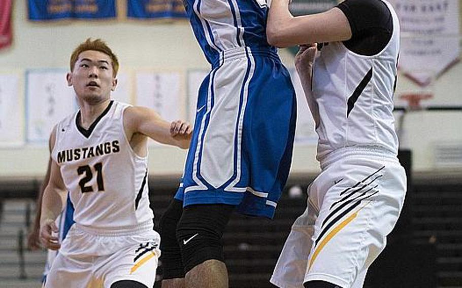 Quintin Metcalf, shown playing in a 2017 Far East Division I Tournament game against American School In Japan, transferred to Humphreys over the summer and now helps lead the unbeaten Blackhawks. They're favored to win the Far East Division II Tournament and could face off with the Mustangs for the combined tournament title later next week.