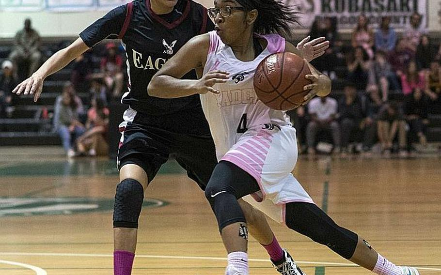 MVP going against MVP in last year's Far East Girls Division I Tournament final at Kubasaki. Kadena's Rhamsey Wyche dribbles against American School of Bangkok's Shainque Lucas during the Eagles' 52-31 win over the Panthers.