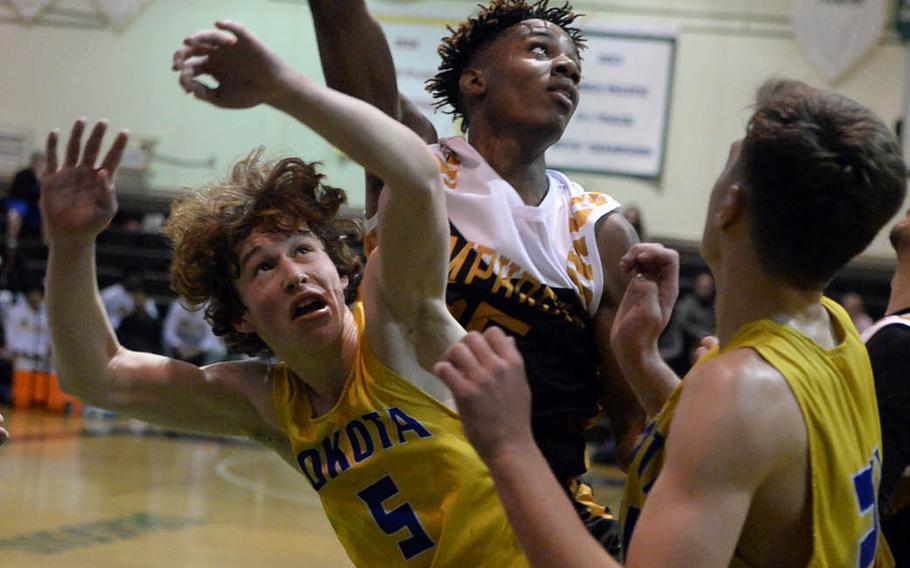 Humphreys' Jalen Hill can't find the handle on the ball against Yokota's Ethan Gaume during Tuesday's final in the Far East Boys Division II Basketball Tournament. The Blackhawks beat Yokota 74-46 for their first D-II basketball title.