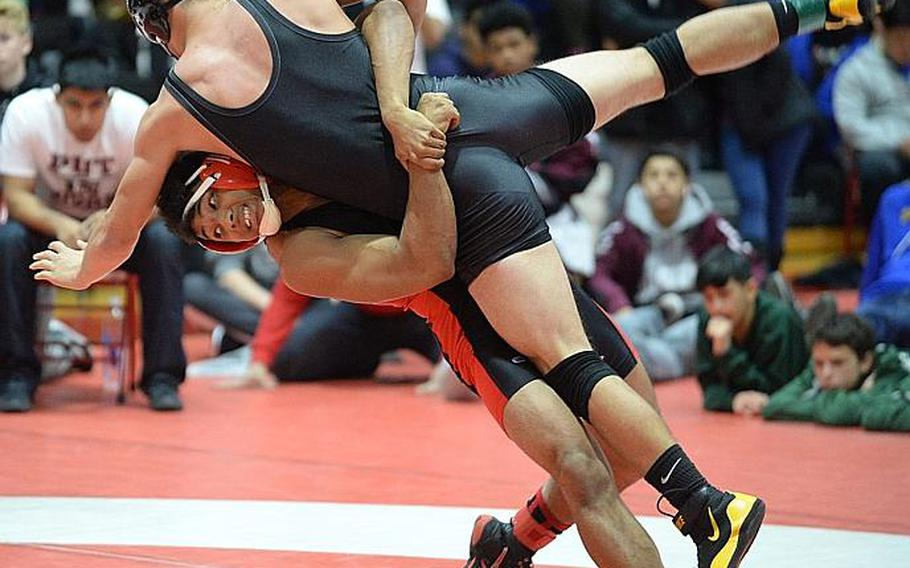 """Nile C. Kinnick's Darius Swenson lifts and scores a two-point throw on Matthew C. Perry's Andrew Borrero in the 158-pound final during the 25th Nile C. Kinnick Invitational """"Beast of the Far East"""" Wrestling Tournament. Swenson beat Borrero by decision 9-6."""