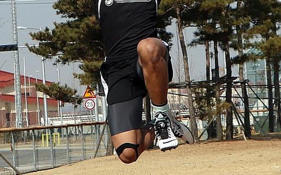 Humphreys' Jaylan Horne, performing the long jump, is one of six boys athletes returning to a Blackhawks team that won the first Far East banner in school history last May.