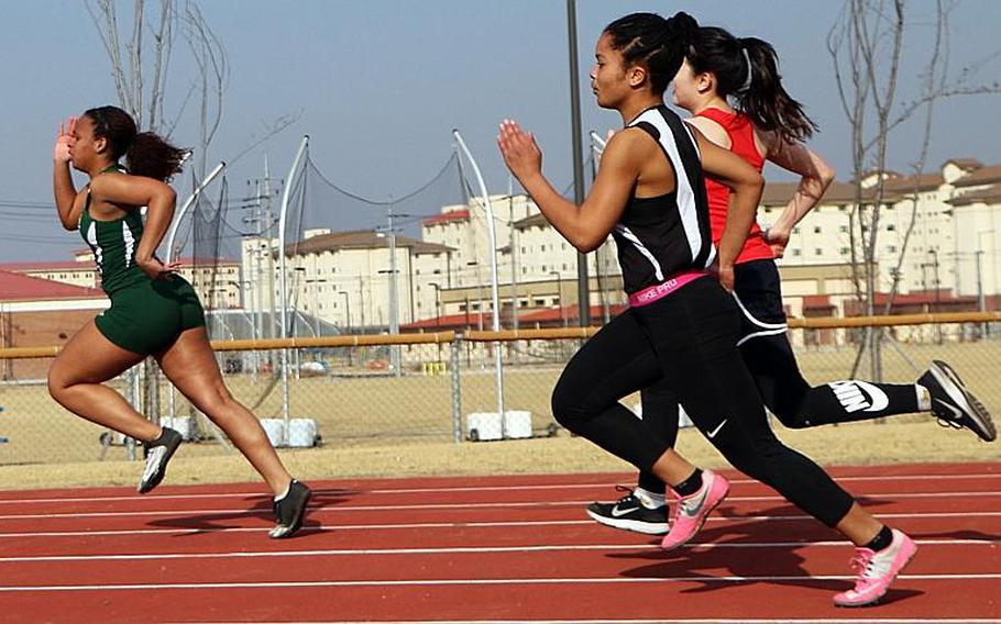 Daegu's Katrina Vasquez leads the pack in the 200 during Saturday's season-opening meet at Humphreys. Trailing Vasquez are Cleopatra Cody of Humphreys and Audrey Choi of Yongsan.