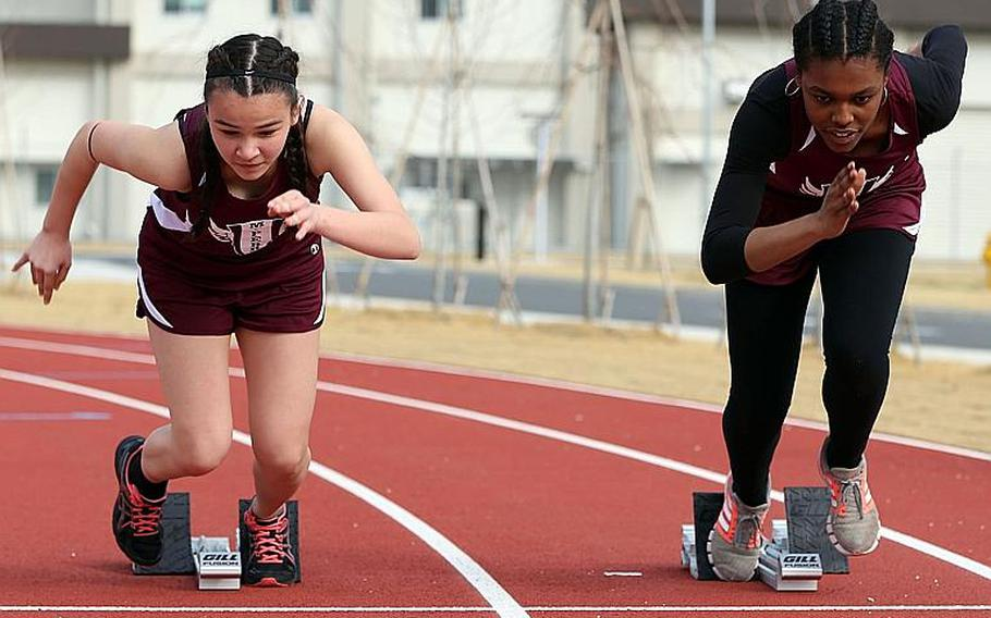 Sprinters Shion Rudolph and Soniah Thompson break out of the starting blocks for first-year track program Matthew C. Perry.