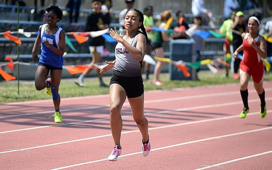 Faith Bryant, center, is the lone returner from Zama's foursome that set a northwest Pacific record in the 400 relay during last May's Far East meet.
