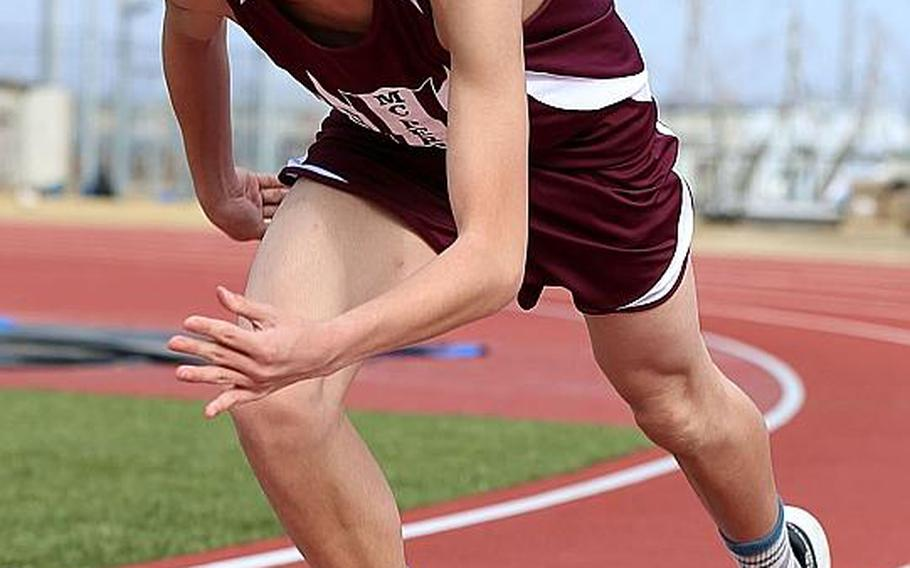 Sprinter Isaiah Kim comes out of the blocks during first-year track program Matthew C. Perry practice.
