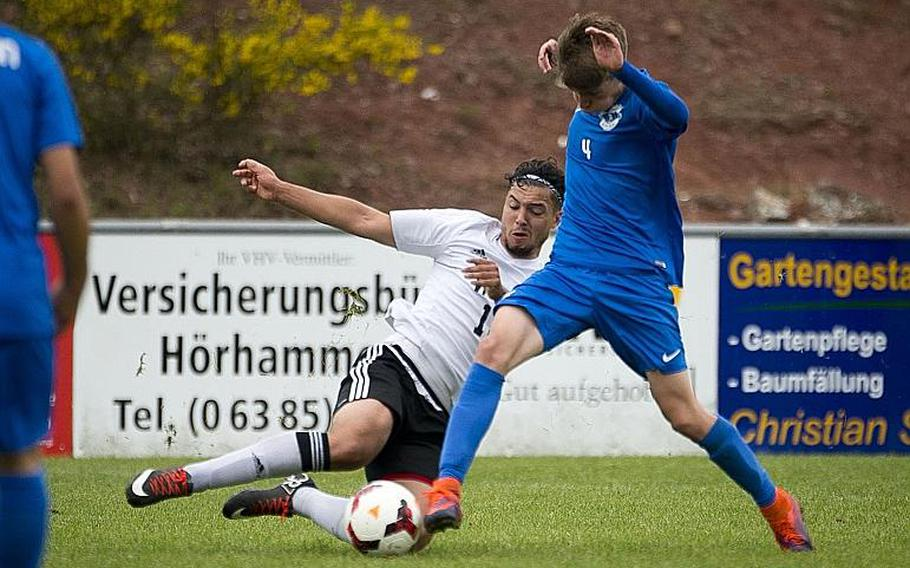 Vicenza's Christopher Ortiz, left, slides to challenge Ramstein's Gavin McMillan during the DODEA-Europe soccer tournament in Reichenbach, Germany, on Thursday, May 18, 2017. Ramstein and Vicenza tied the Division I match 1-1 and Ramstein advanced to the semifinals.