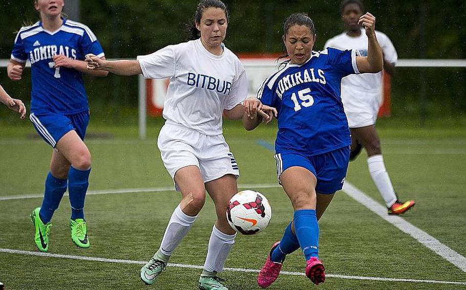 Bitburg's Emma Passig, left, and Rota's Jasmine Garrison race for the ball during the DODEA-Europe Division II semifinals in Reichenbach, Germany, on Friday, May 19, 2017.