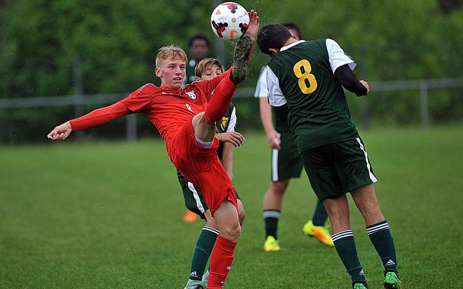 Kaiserslautern's Tyler Jankowski knocks the ball upfield against SHAPE's Roberto Liano in a Division I semifinal at the DODEA-Europe soccer finals in Reichenbach, Germany.   Michael Abrams/Stars and Stripes