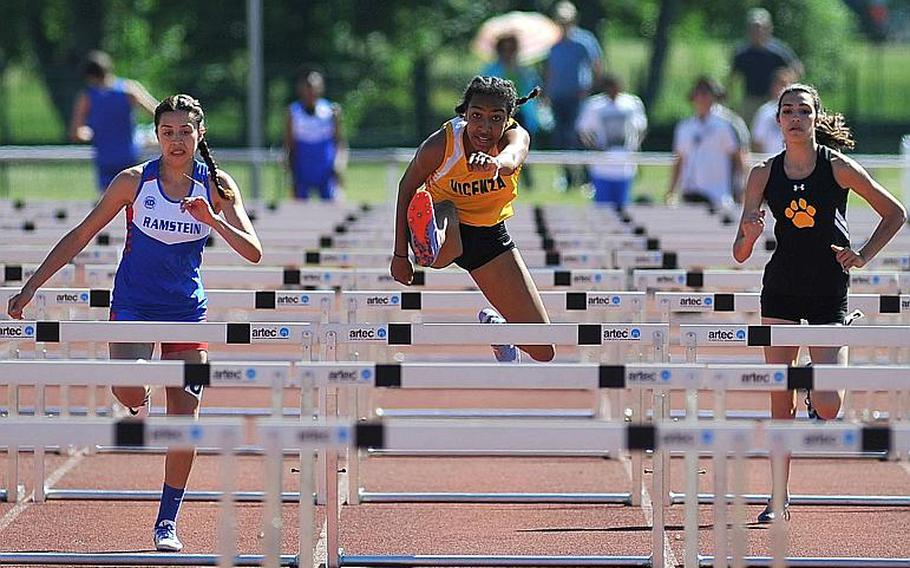 Vicenza's Brandy James, center, on her way to winning the 100-meter hurdles race at the DODEA-Europe track and field finals in Kaiserslautern, Germany, Saturday, May 27, 2017. She won in 15.74 seconds. At left is Ramstein's Sybella Crespo, who was second and Stuttgart's Annika Rivera, who was fifth.     Michael Abrams/Stars and Stripes