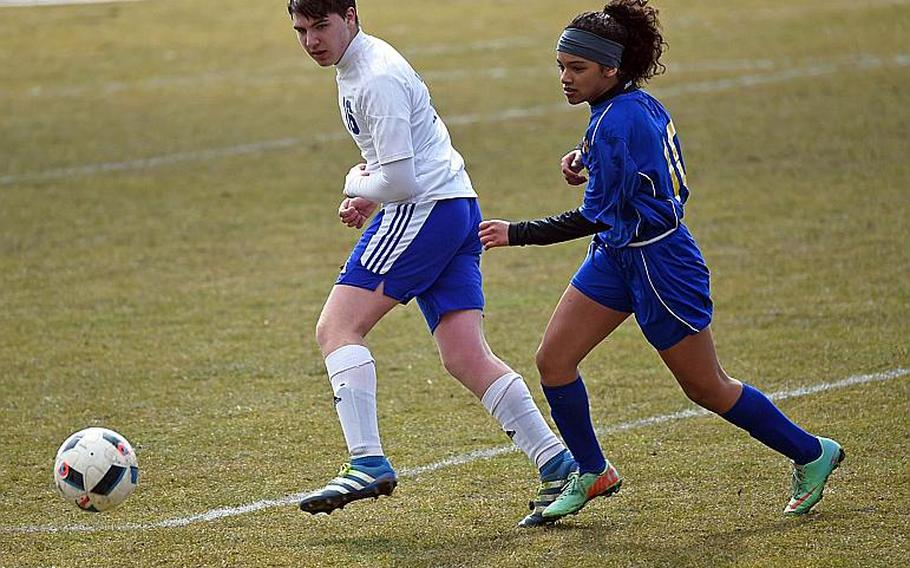 Ansbach's Desha Boswell, right, and Hohenfels' Shane Colbert, race to the ball during a match at Hohenfels, Germany, Saturday, March 24, 2018.