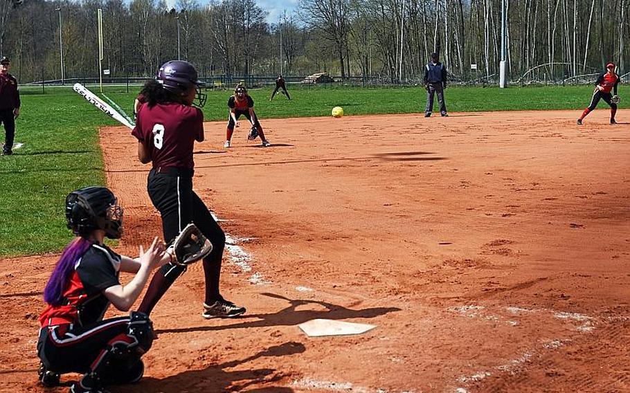 Vilseck's Joanne Baker hits the ball in a game against Kaiserslautern at Vilseck, Germany, Saturday, April 14, 2018.