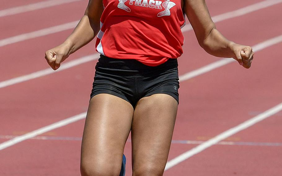 Nile C. Kinnick's Debrianna Ellis pulls up after crossing the finish first in the girls 100 in 13.03 seconds during Saturday's DODEA Japan-Kanto Plain track and field meet.
