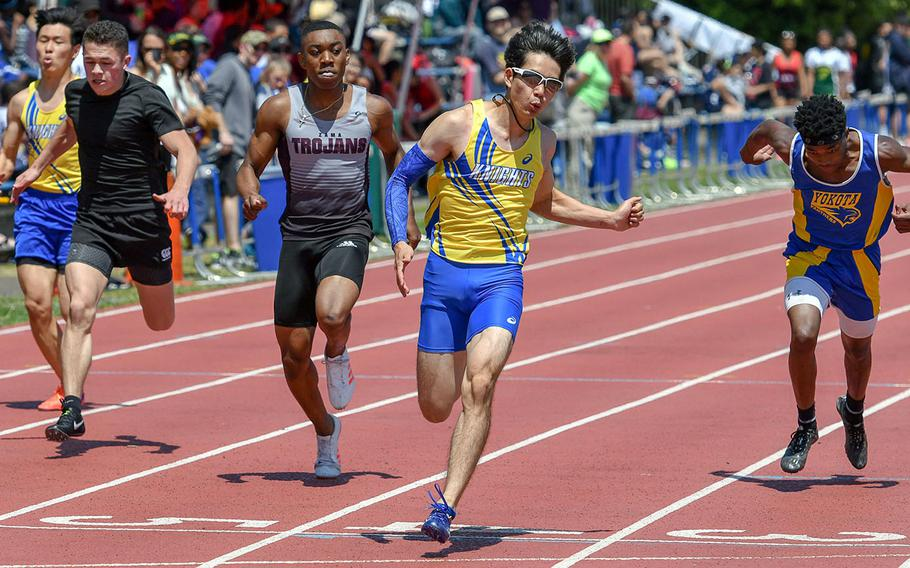 Christian Academy Japan's Kaito Suzuki crosses the line first in the boys 100 in 11.01 seconds during Saturday's DODEA Japan-Kanto Plain track and field meet.