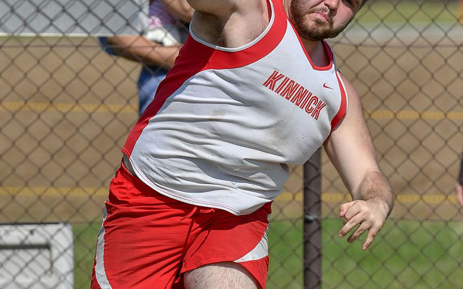 Nile C. Kinnick's Connor Joley lets loose with a shot-put toss of 12.46 meters, good for second behind teammate Kameron Leon Guerrero (12.70) during Saturday's DODEA Japan-Kanto Plain track and field meet.