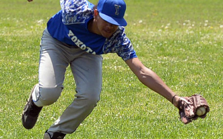 Yokota right fielder Richard Stowe snags a line drive against Zama during the DODEA Japan boys baseball tournament. Yokota won 5-2, finished 4-0 and won the tournament for the third straight year.