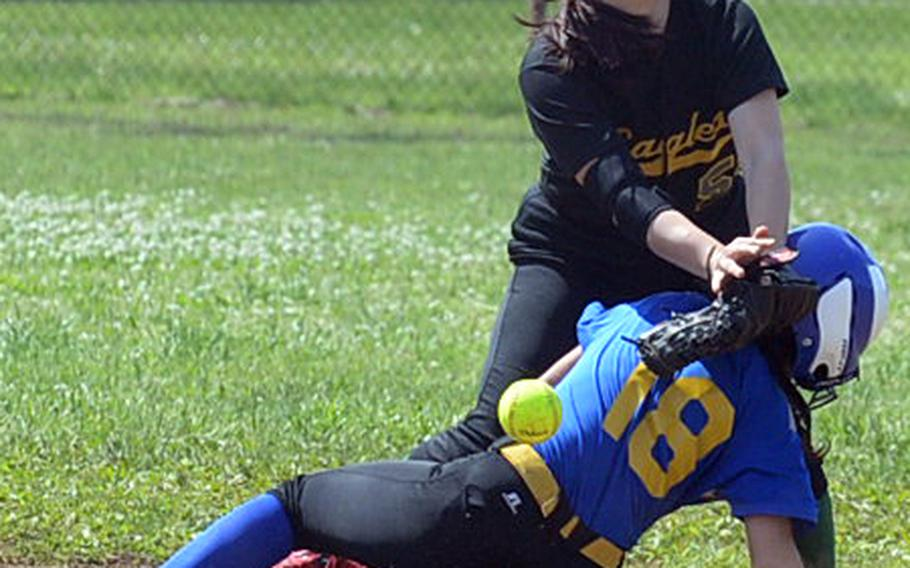 Yokota's Annalise Rodriguez slides safely into second base as Robert D. Edgren shortstop Veronica Crawford can't find the handle on the ball during Saturday's DODEA Japan softball tournament finals. The Eagles rallied past the Panthers 13-12 to win the tournament for the first time in school history.
