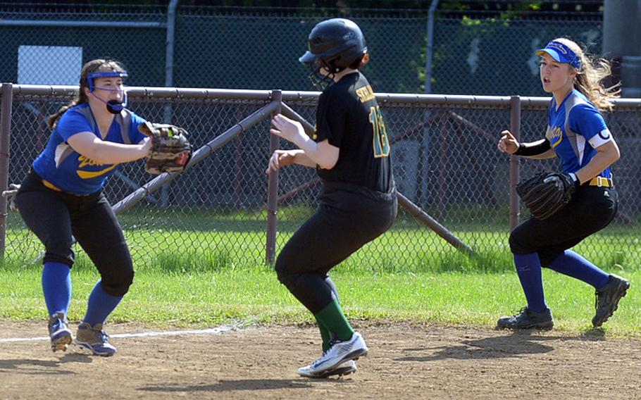 Eagle in a pickle. Robert D. Edgren's Caitlin Haydam finds herself caught between Yokota infielders Katie Lambie and Madison Derber during Saturday's DODEA Japan softball tournament final. The Eagles rallied past the Panthers 13-12 for their first title in this tournament's history.