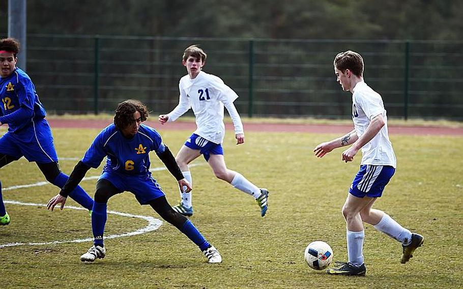 Ansbach's Zach Blaser, right, brings the ball towards Hohenfels' goal, during a match at Hohenfels, Germany, Saturday, March 24, 2018.  Martin Egnash/Stars and Stripes
