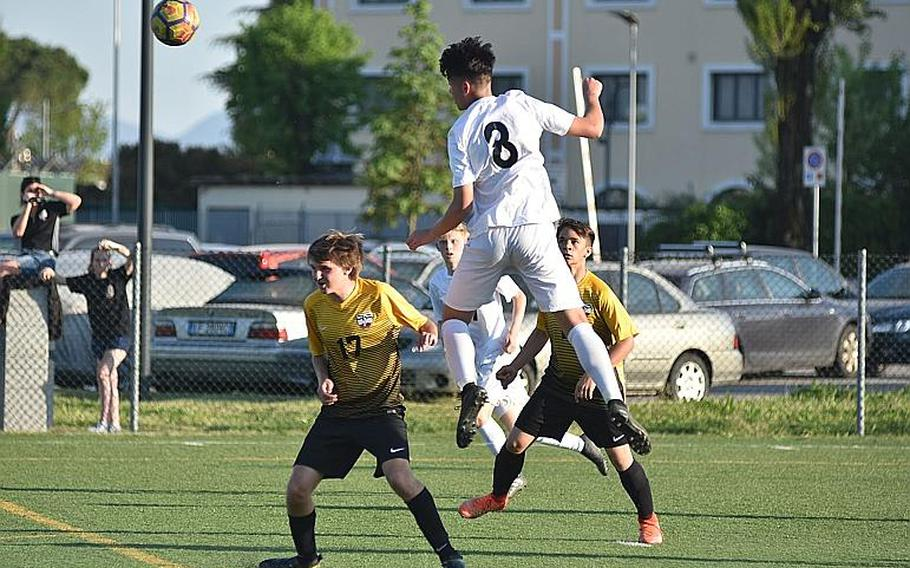 Naples' Chase Traylor goes high to head the ball away from the Naples goal on Friday, April 20, 2018, in Vicenza, Italy.  Kent Harris/Stars and Stripes