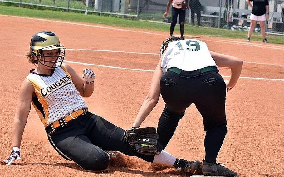 Vicenza's Bethany Williams is tagged out by Naples' Emily Kras at third base on Friday, May 11, 2018.