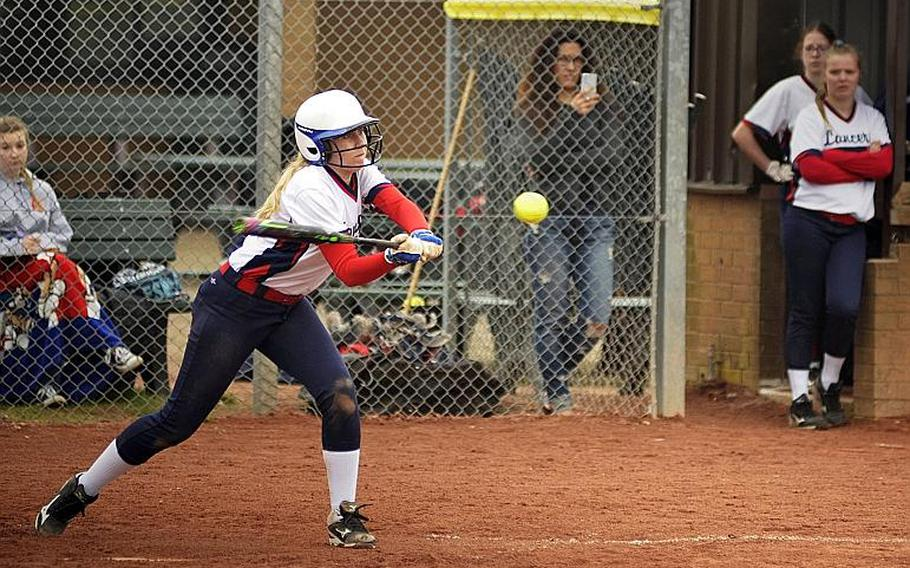 Lakenheath???s Paige Nielsen keeps her eye on the ball while batting against Spangdahlem during a doubleheader at RAF Lakenheath, England, Saturday, April 14, 2018.