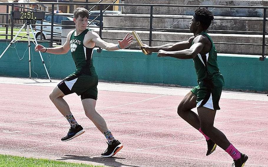 Naples' Johna Joseph passes the baton to anchor Tim Smith in the 4x400 relay on Saturday May 13, 2018 at Naples Middle High School. They would win the event.