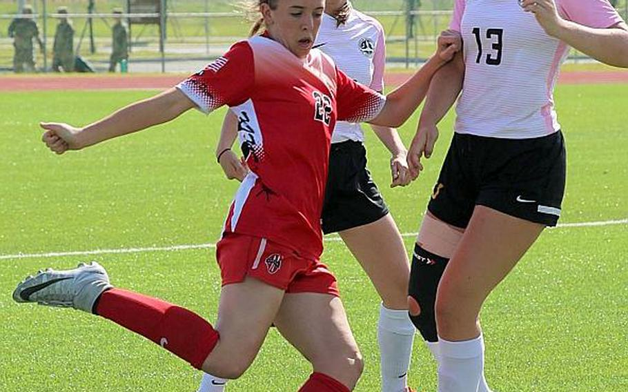Nile C. Kinnick's Maggie Donnelly tries to clear the ball away from American School In Japan defenders during Wednesday's championship match in the Far East Division I girls soccer tournament. The Mustangs dethroned the defending champion Red Devils 5-3.
