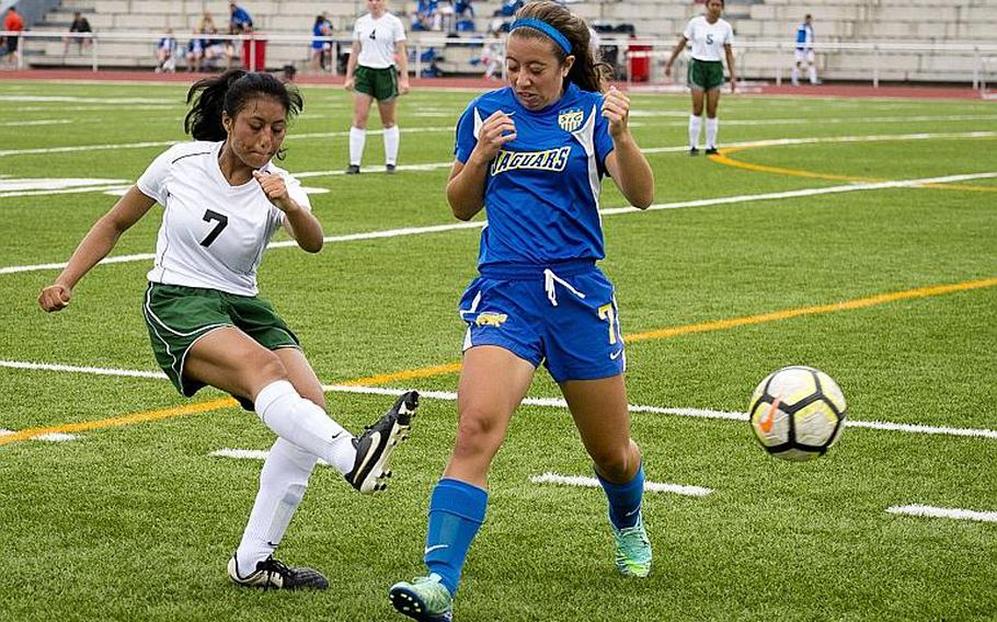 Alconbury's Victoria Flores, left, passes the ball around Sigonella's Emmy McCarthy during the DODEA-Europe Division III soccer championship in Kaiserslautern, Germany, on Thursday, May 24, 2018.