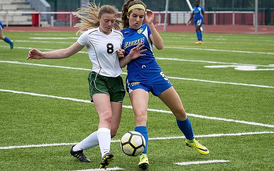 Alconbury's Haley Starr, left, and Sigonella's Alex Garcia challenge each other for the ball during the DODEA-Europe Division III soccer championship in Kaiserslautern, Germany, on Thursday, May 24, 2018. Alconbury won the game 1-0.