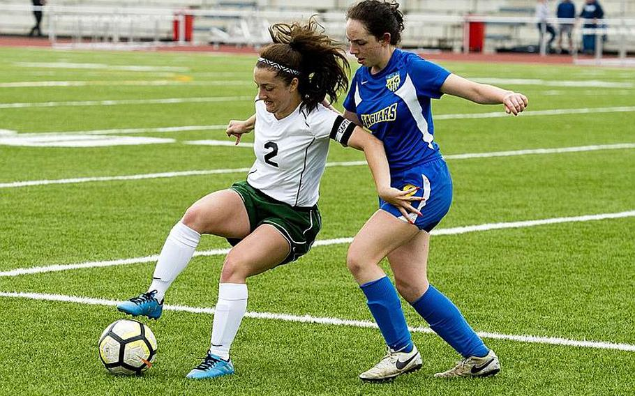 Alconbury's Isabel Black, left, tries to dribble past Sigonella's Cecelia Warren during the DODEA-Europe Division III soccer championship in Kaiserslautern, Germany, on Thursday, May 24, 2018.