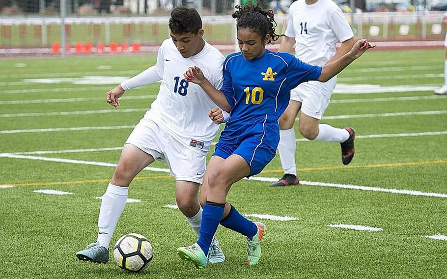 Ansbach's Dasha Boswell, right, and Brussels' Alejandro Pantaleon battle for the ball during the DODEA-Europe Division III soccer championship in Kaiserslautern, Germany, on Thursday, May 24, 2018.