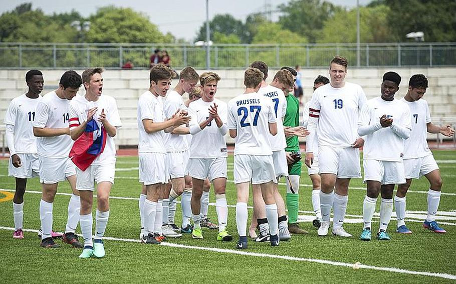 Brussels celebrates a 7-0 victory over Ansbach to win the DODEA-Europe Division III soccer championship in Kaiserslautern, Germany, on Thursday, May 24, 2018.