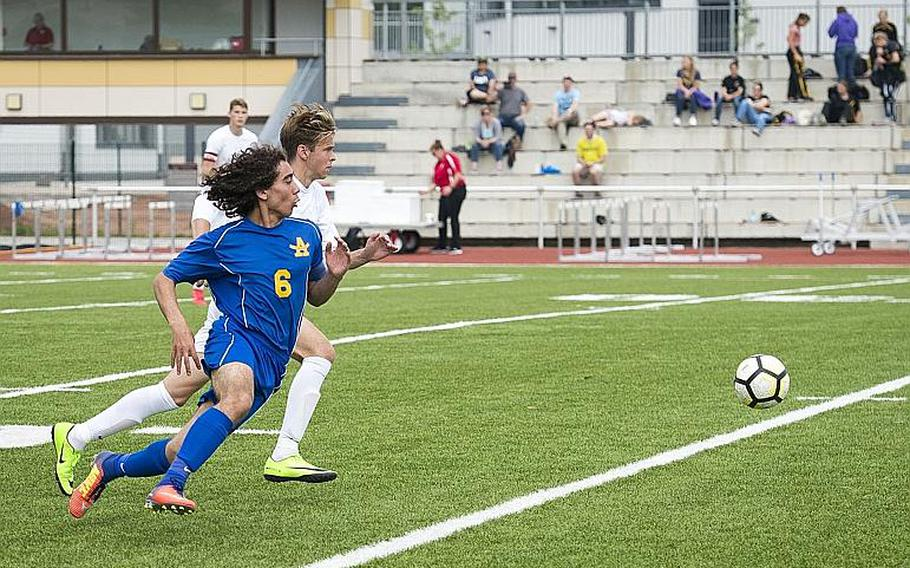 Ansbach's Giancarlo Solito, left, and Brussels' Noah Gray race for the ball during the DODEA-Europe Division III soccer championship in Kaiserslautern, Germany, on Thursday, May 24, 2018. Brussels won the game 7-0.