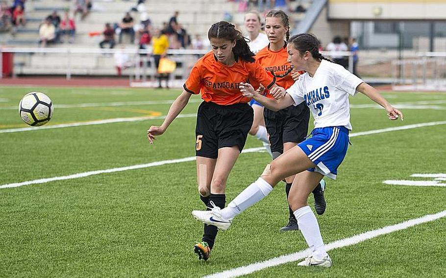 Rota's Avery Nancy, right, passes the ball in front of Spangdhalem's Andrea Mercado during the DODEA-Europe Division II soccer championship in Kaiserslautern, Germany, on Thursday, May 24, 2018. Rota lost the game 2-0.