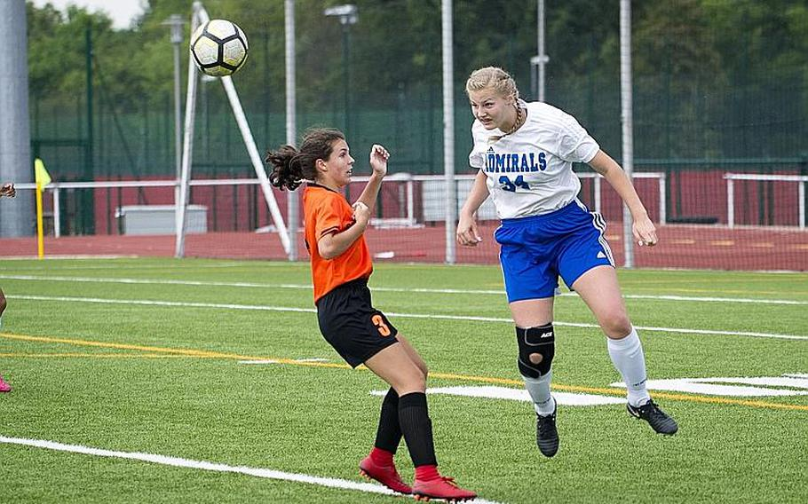 Rota's Jacqueline Holtz, right, heads the ball over Spangdhalem's Emma Passig during the DODEA-Europe Division II soccer championship in Kaiserslautern, Germany, on Thursday, May 24, 2018.