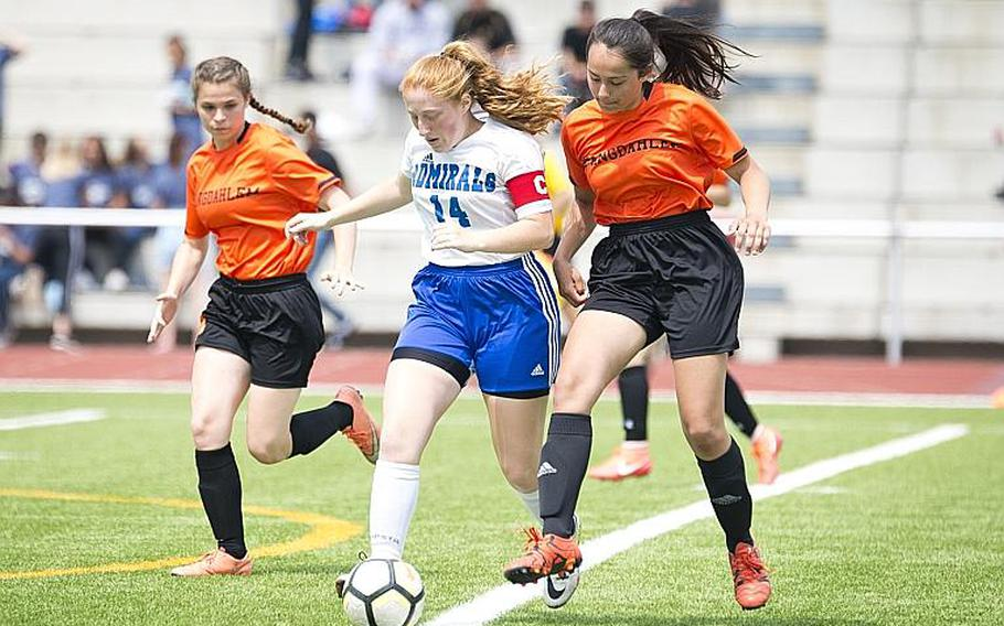 Rota's Emma Hook dribbles between Spangdhalem's Tahlia Mower-Scheid, left, and Emelia Lenz during the DODEA-Europe Division II soccer championship in Kaiserslautern, Germany, on Thursday, May 24, 2018.