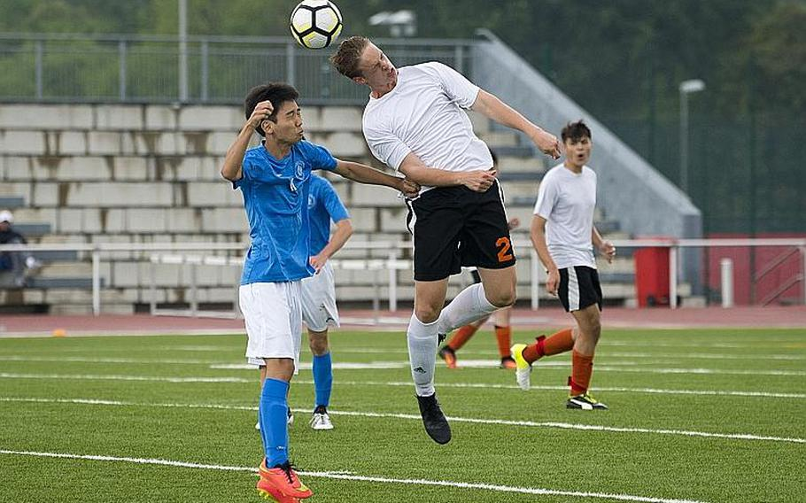 AFNORTH's Seth BonenClark, right, and Marymount's Chan Sol Park jump for a header during the DODEA-Europe Division II soccer championship in Kaiserslautern, Germany, on Thursday, May 24, 2018.