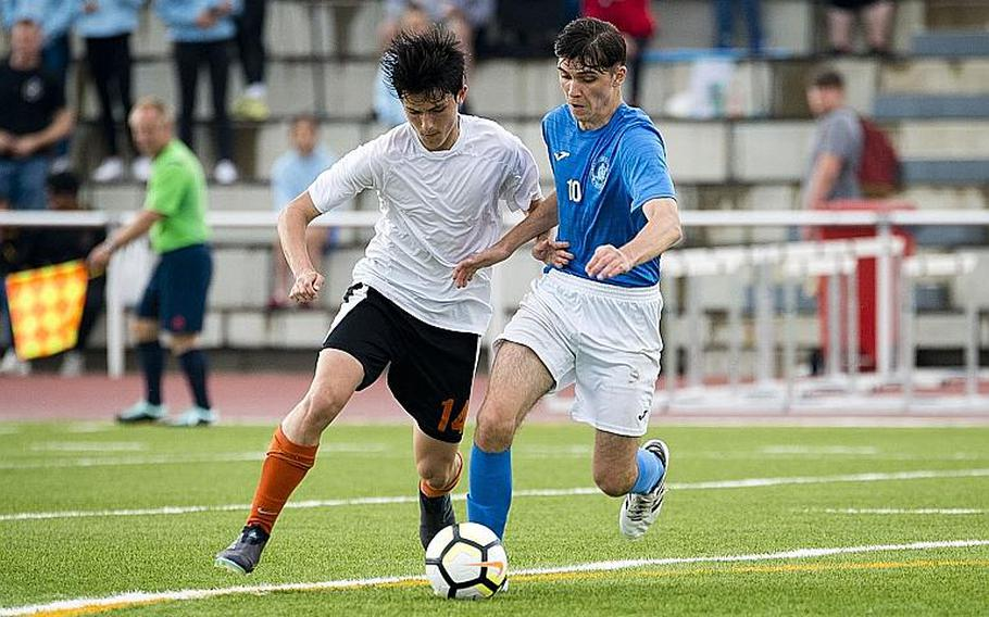 Marymount's Alexander Herne, right, and AFNORTH's James Barata battle for the ball during the DODEA-Europe Division II soccer championship in Kaiserslautern, Germany, on Thursday, May 24, 2018.